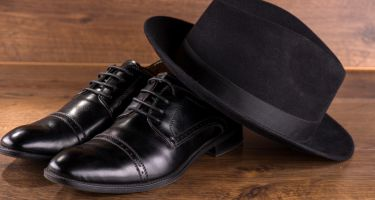 black patent leather shoes on floor